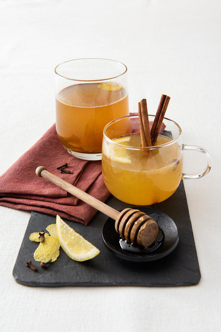 Tea punch with lemon syrup, spices and whisky