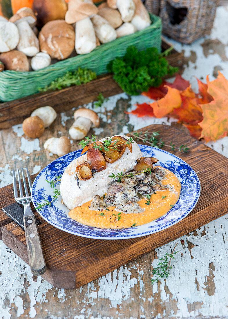 Roast chicken breast with pumpkin puree and creamy mushroom sauce