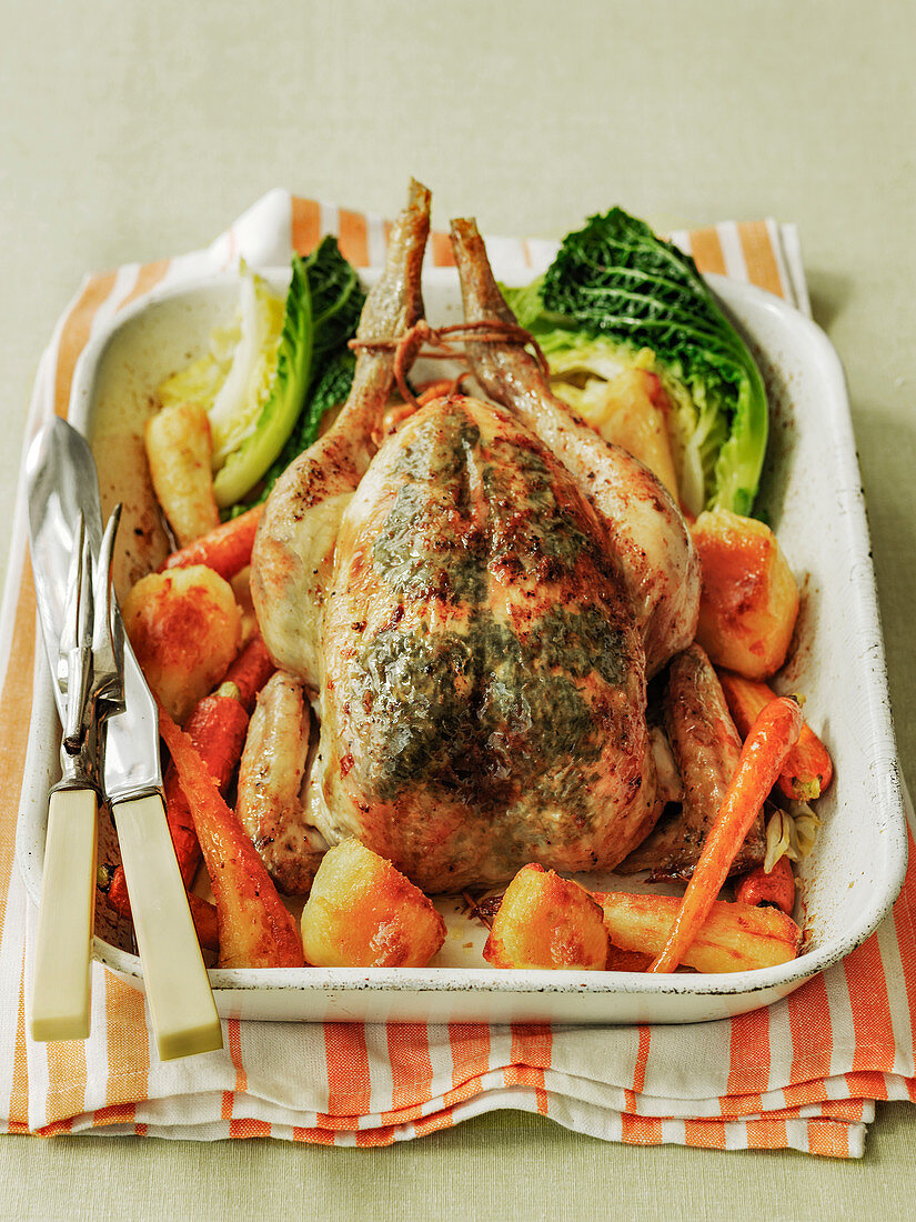Roast chicken with potatoes, carrots and cabbage