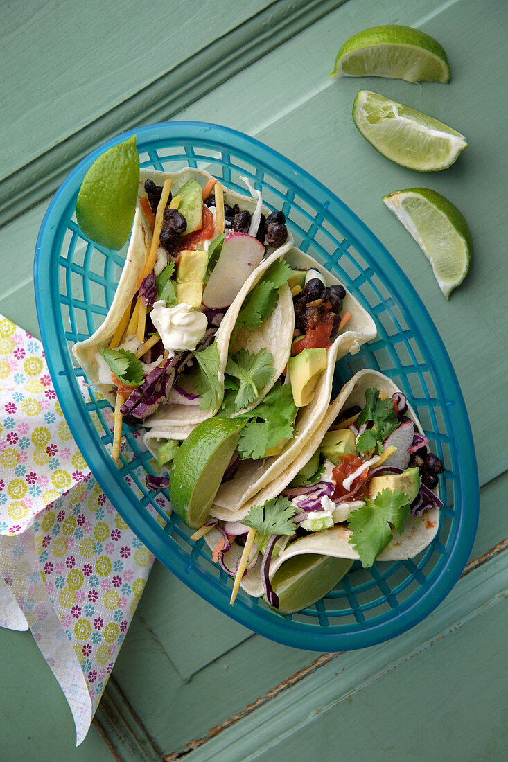 Vegetarian tacos filled with black beans and avocado
