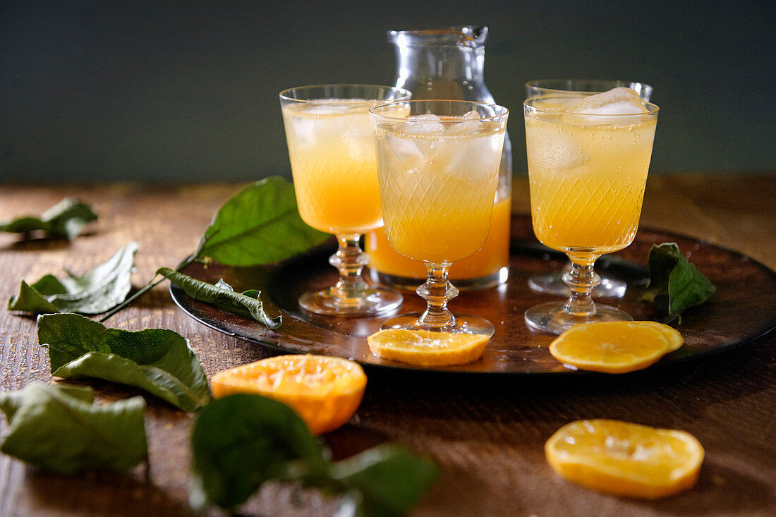 An orange cocktail over ice
