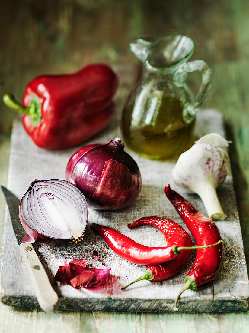 Selection of Spanish food ingredients - olive oil garlic red chillies red onions and red pepper