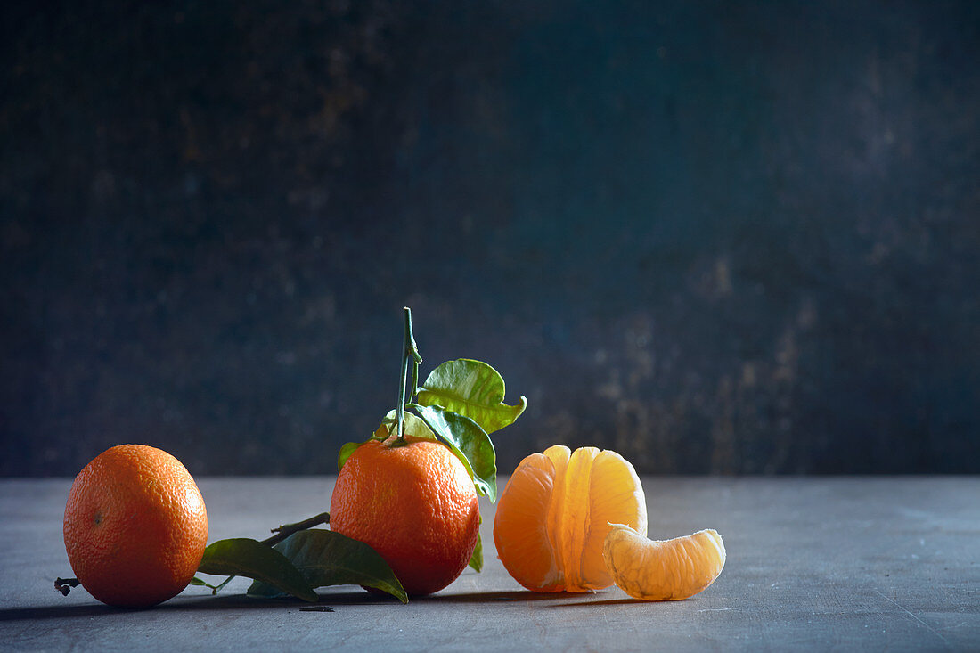 Three mandarins, one peeled