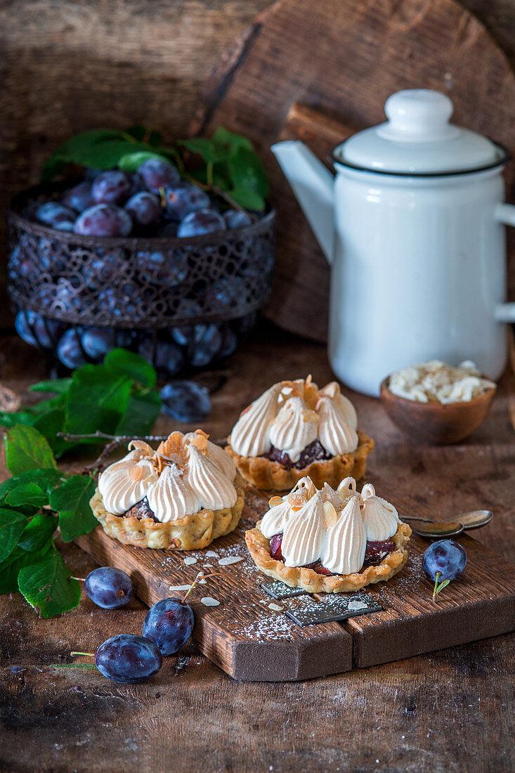 Plum meringue pies