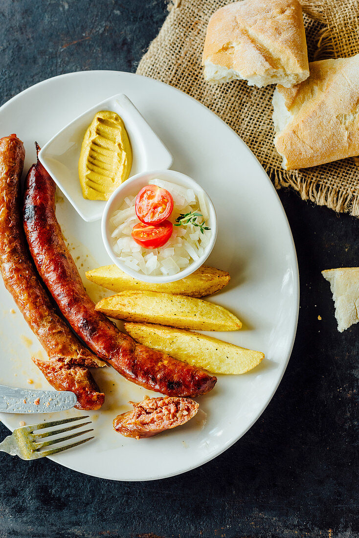 Grilled sausages, french fries and onions