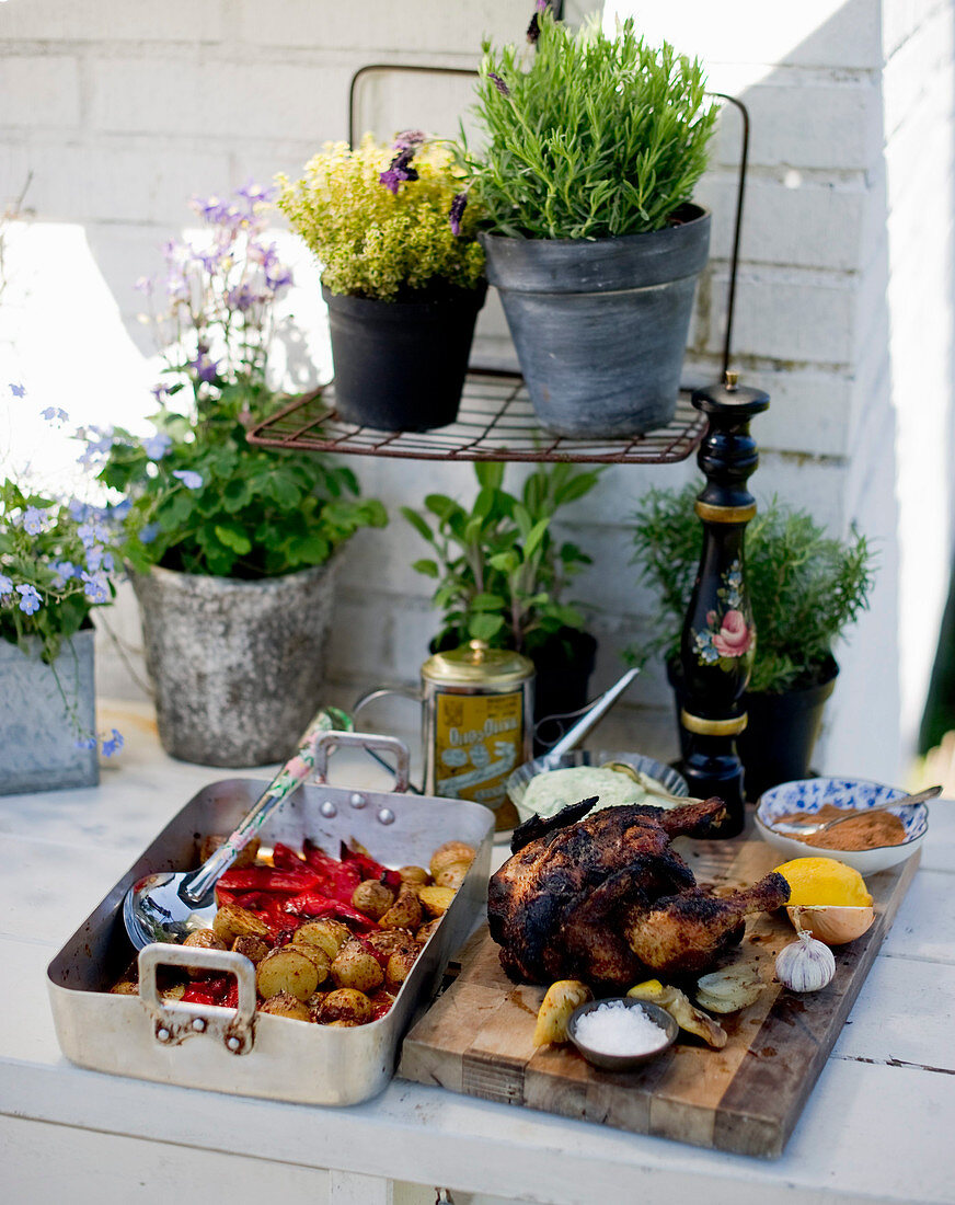Beer can chicken with grilled potatoes