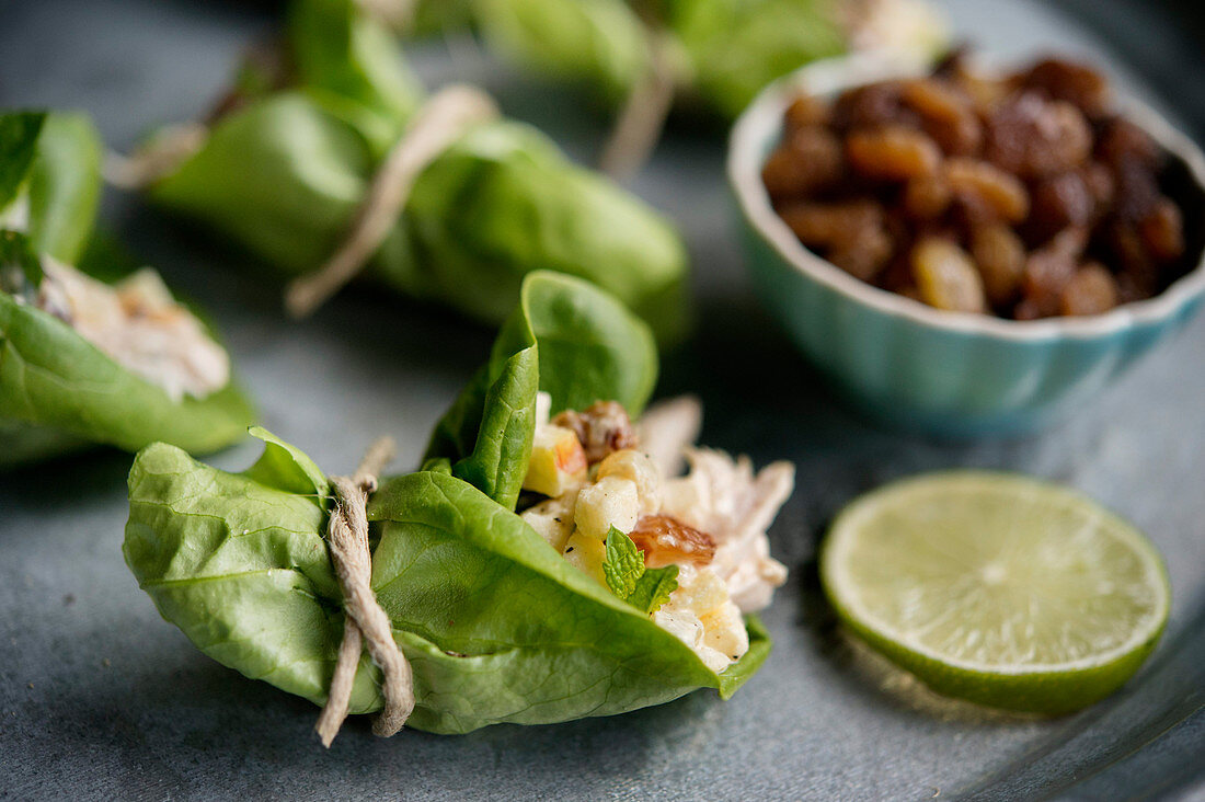 Salpicão (Brazilian chicken salad) in lettuce leaves