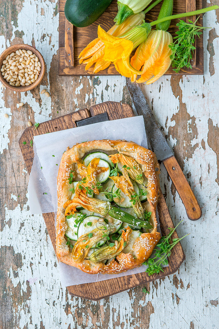 Zucchini flower pie with pine nuts