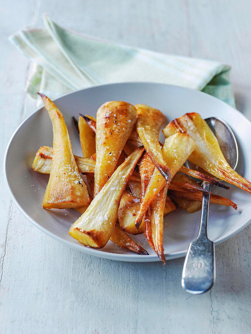 Roast parsnips in a serving bowl