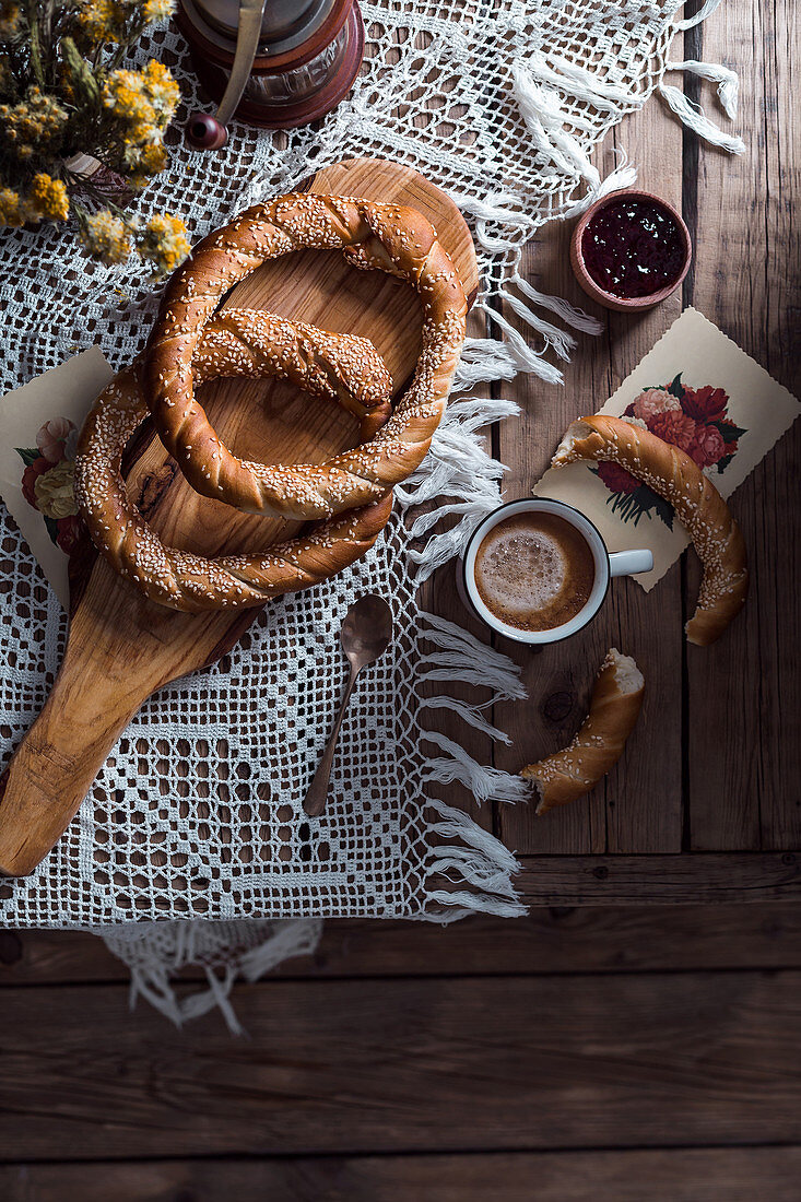 Tasty circle-shaped pastry and cup of cocoa