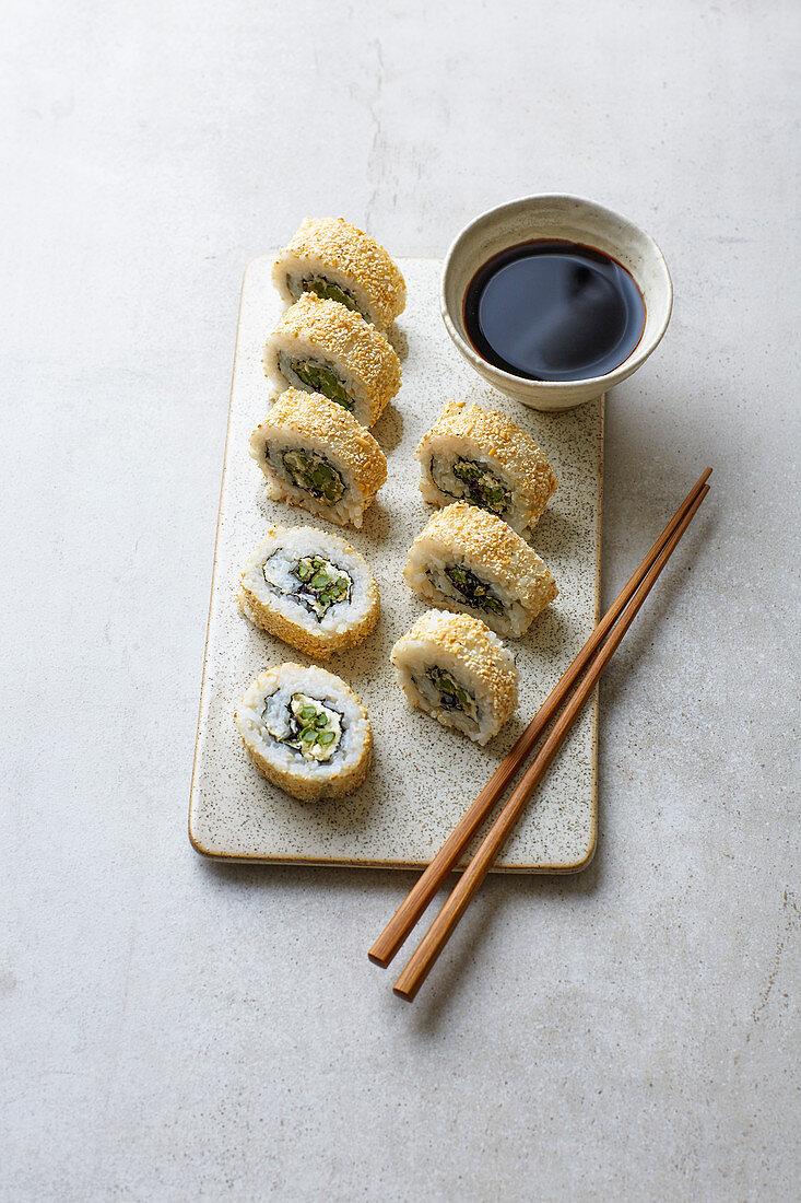 California rolls with cream cheese, asparagus tempura and roasted rice