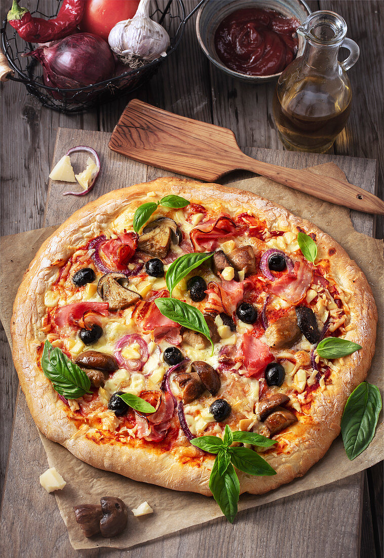 Pizza Veronese with tomatoes, mozzarella, mushrooms and prosciutto