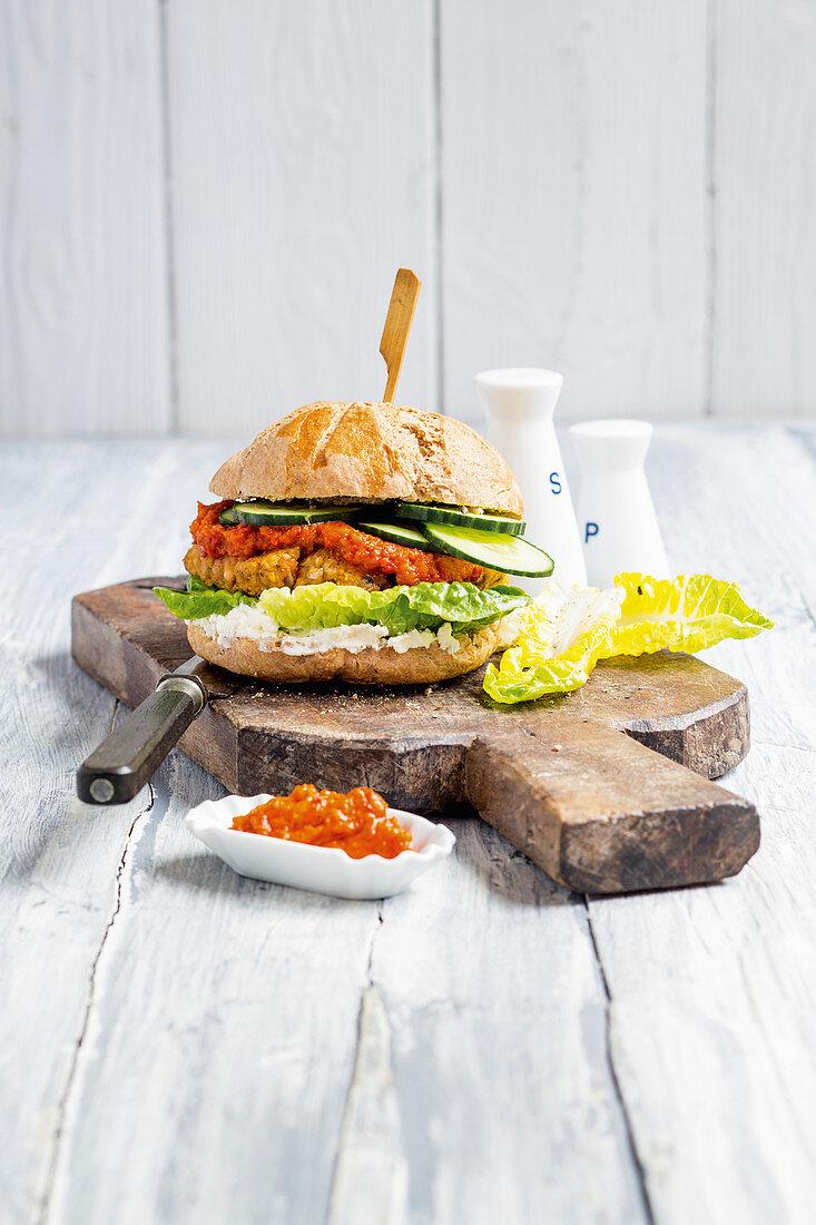 Vegetarian lentil burger with ajvar