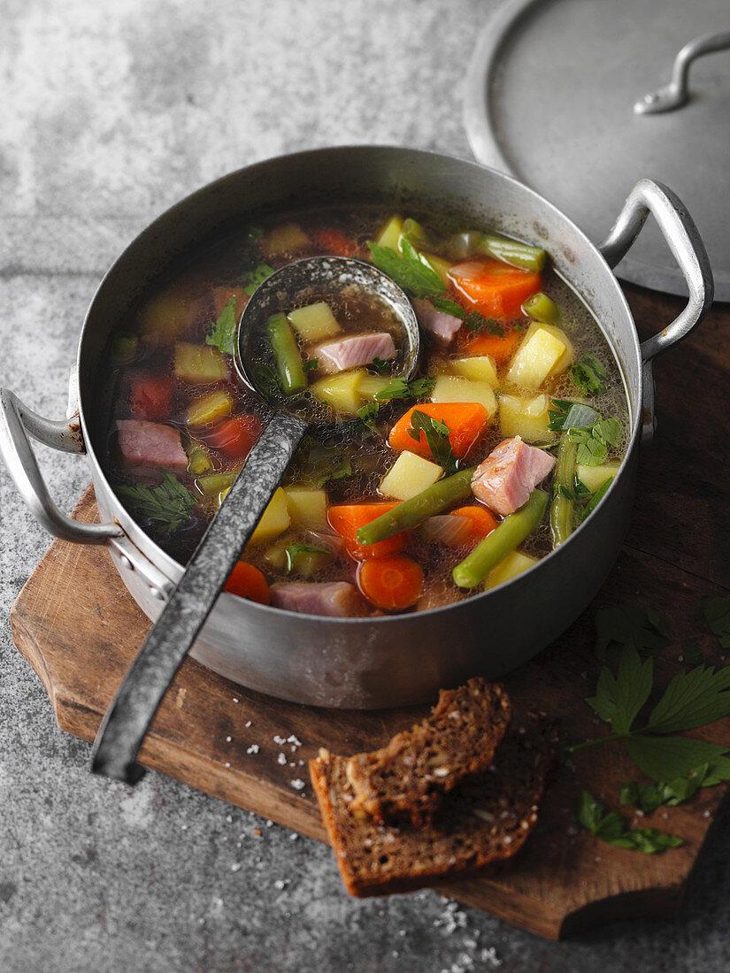 Hearty 'Wurzelstippelse' – vegetable stew with gammon, North-Rhine Westphalia, Germany