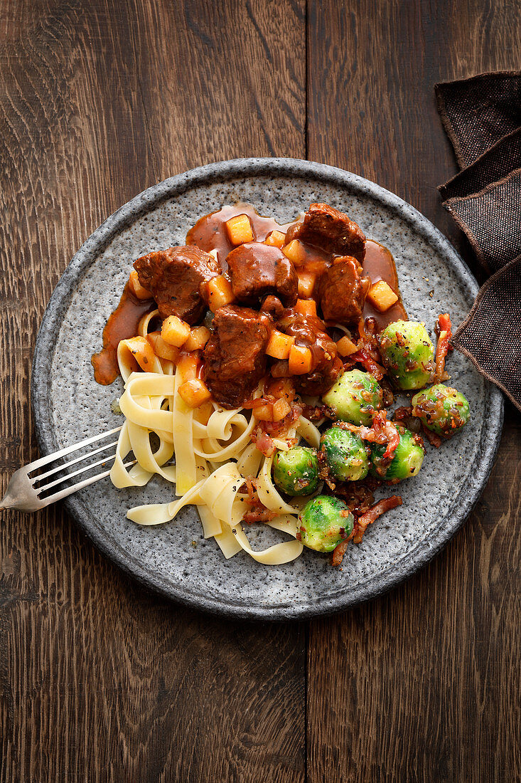 Boar and pear ragout with brussels sprouts and tagliatelle