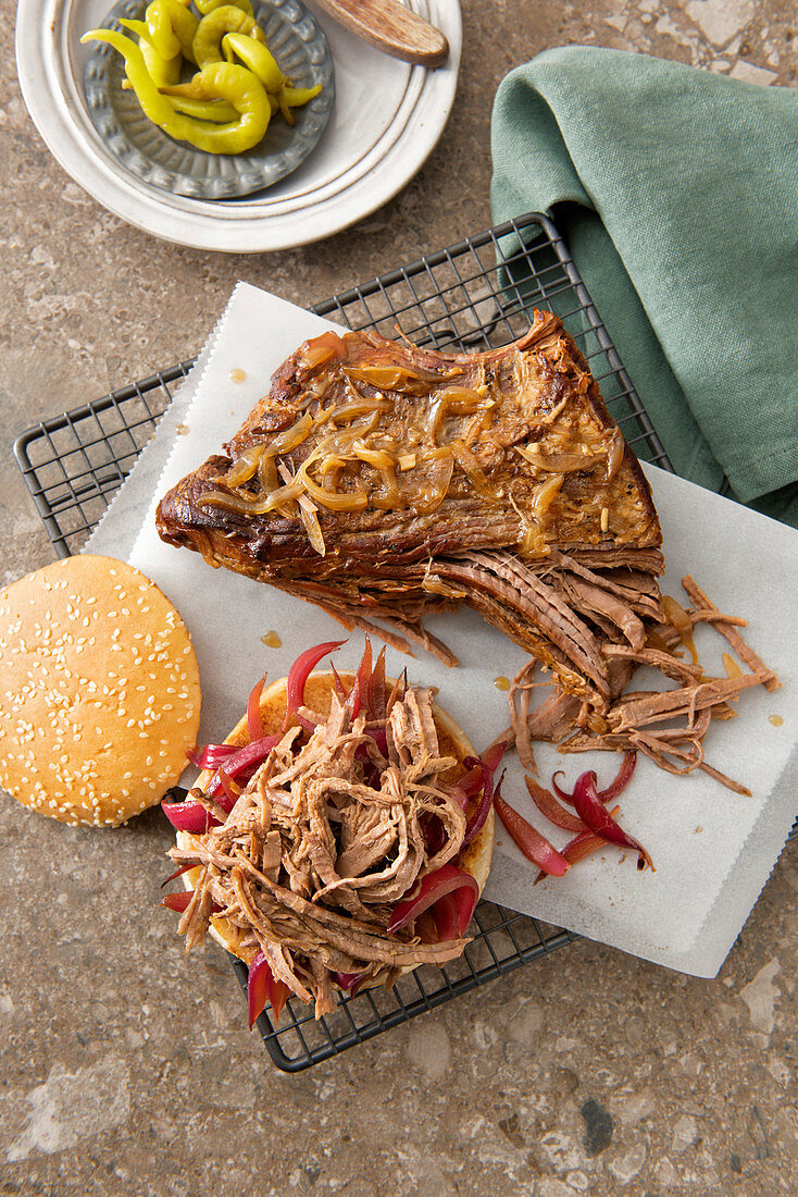 Pulled beef brisket with caramelized red onions in a bun