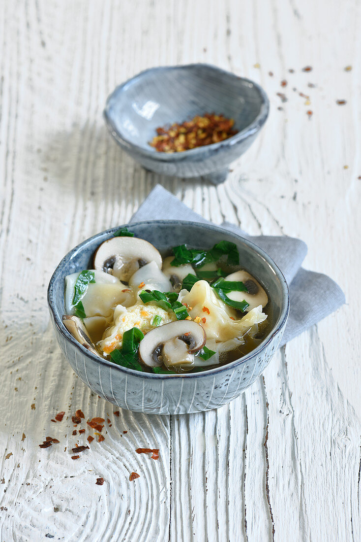 Wonton soup with mushrooms, water chestnuts and spinach