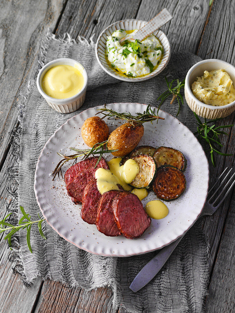 Ostrich fillet with rosemary potatoes and sliced courgettes