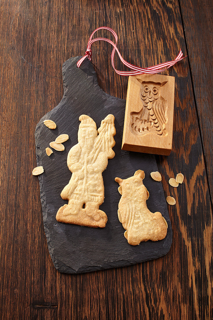 Gingerbread with an embossing stamp on a slate board