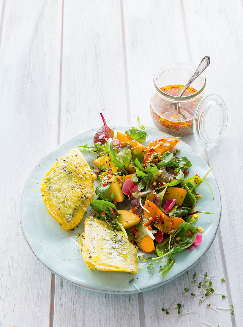 Seabream fillets on an apricot and peach salad
