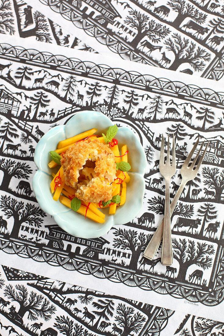 Pumpkin dumpling on a mango and chilli salad