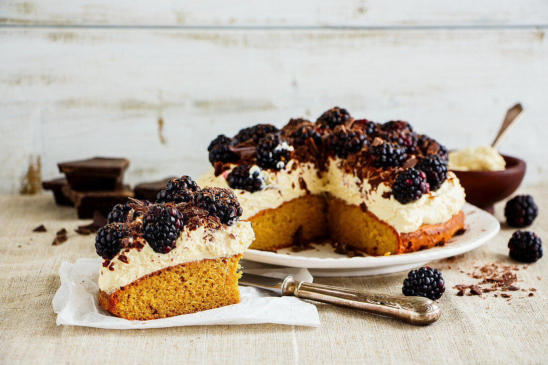 Sliced blackberry cake with mascarpone cream and chocolate