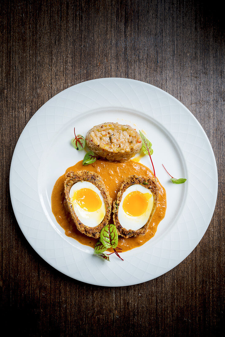 Spiced Scotch egg curry with soft chilli risotto