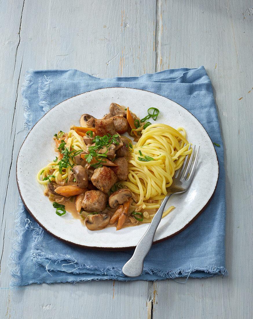 Sausage and mushroom ragout with tagliatelle