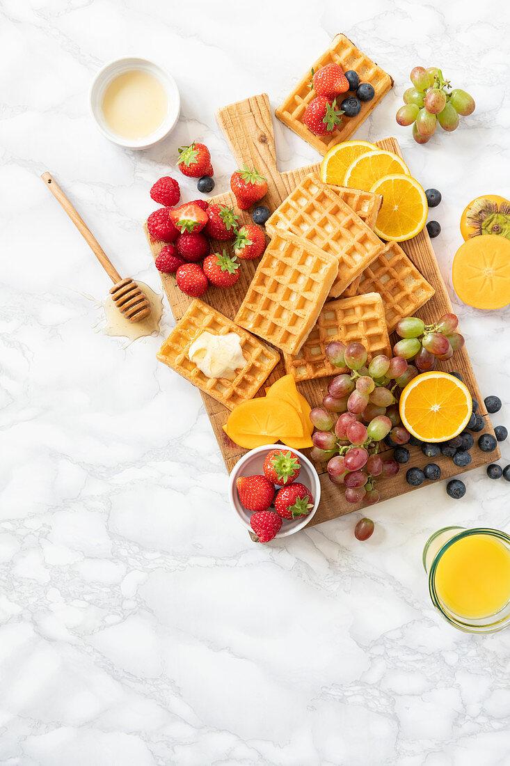 Waffles with fruits and orange juice