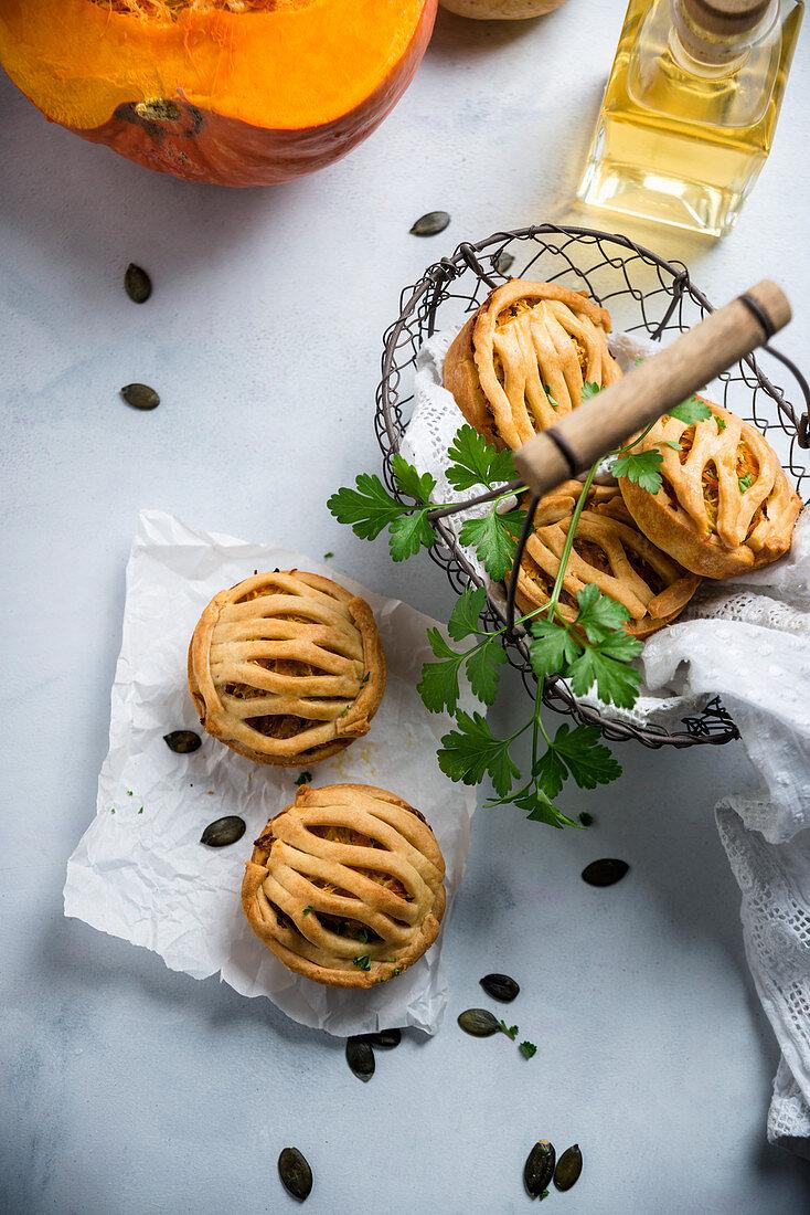 Shortcrust vegan muffins filled with a pumpkin and potato gratin