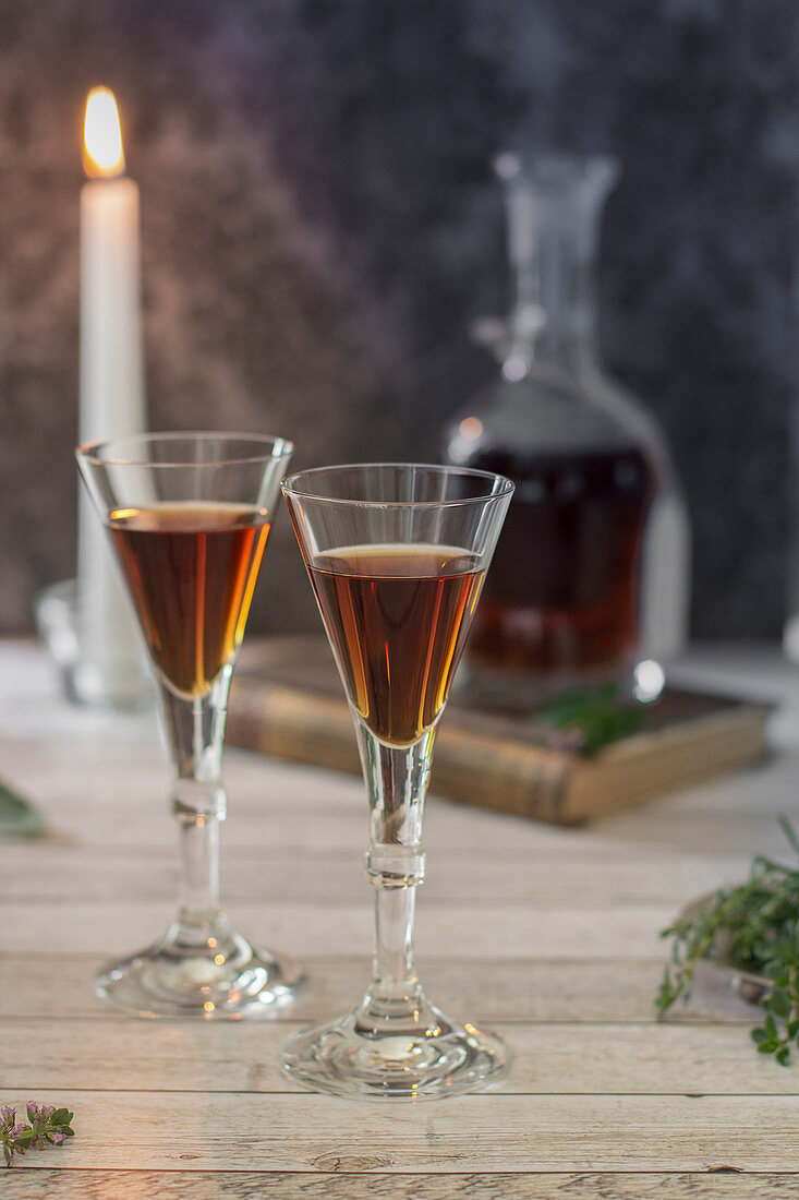 Two glasses of herbal liqueur