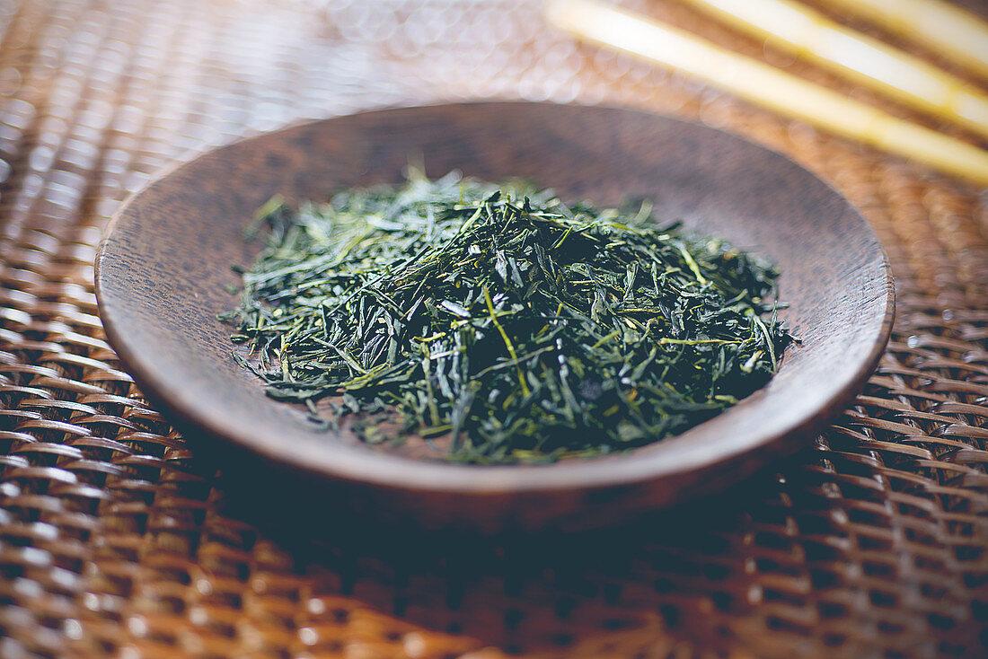 Loose green tea on a plate