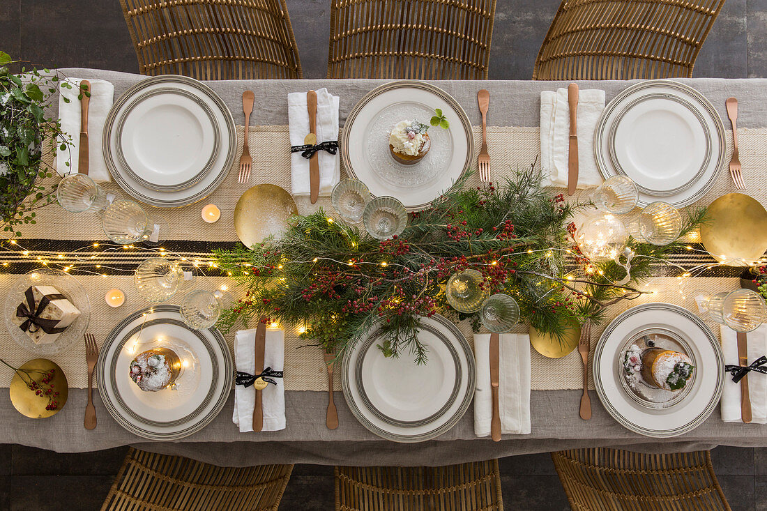 Arrangement of branches on festively set table