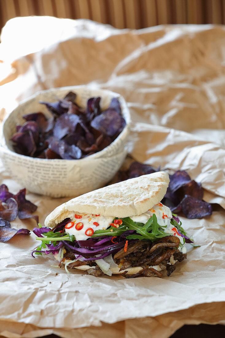 Donner kebab with mushrooms and purple potato crisps