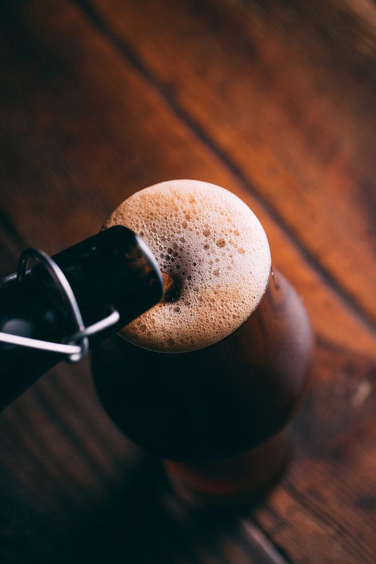 Dark beer being poured
