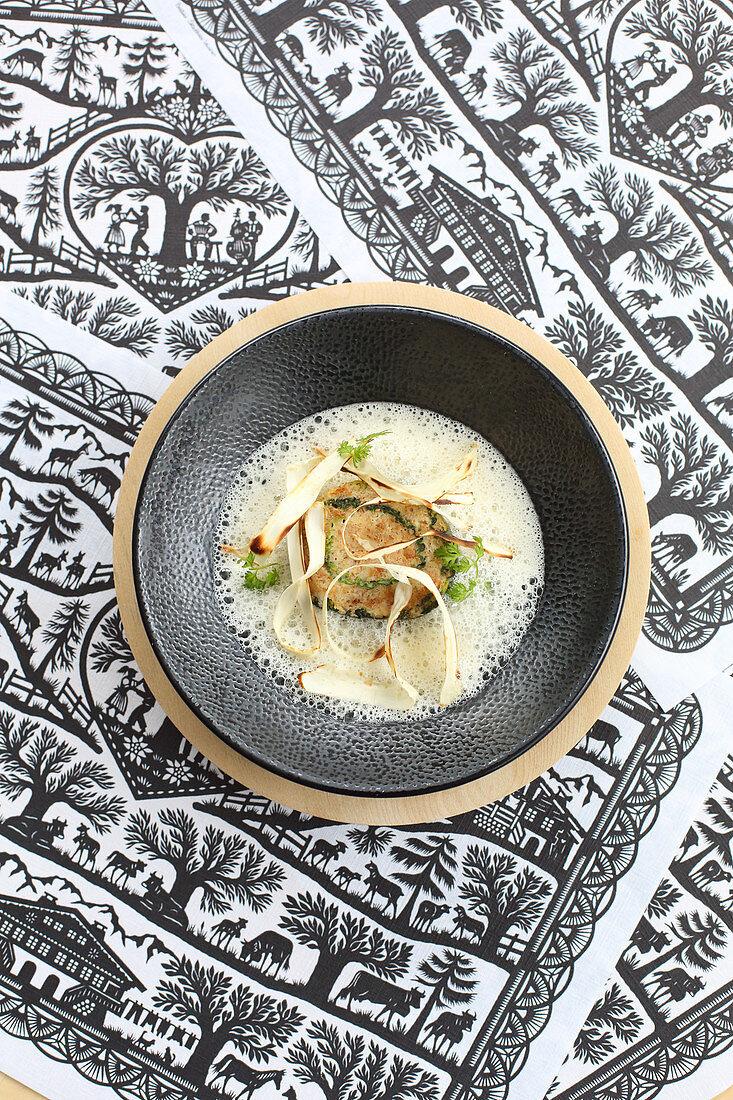 Savoy cabbage dumplings on horseradish foam