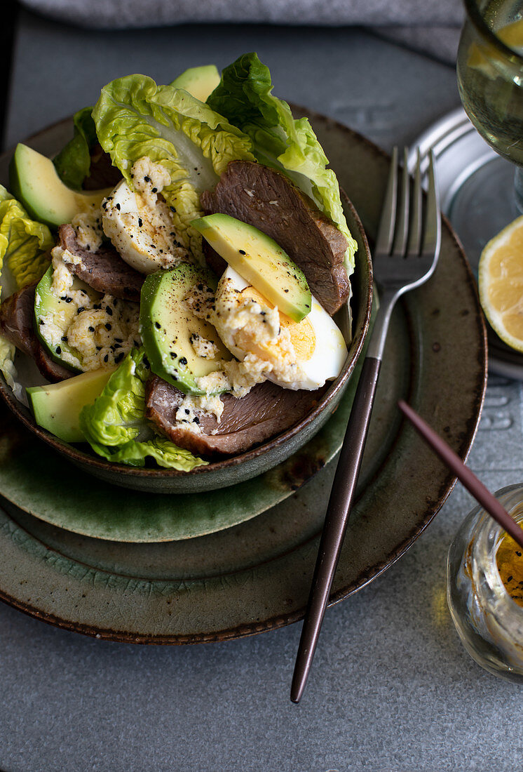 Avocado salad with goose meat and eggs