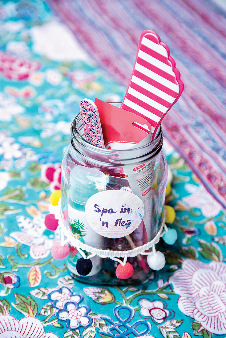 Spa tools in a labelled jar on a Moroccan tablecloth