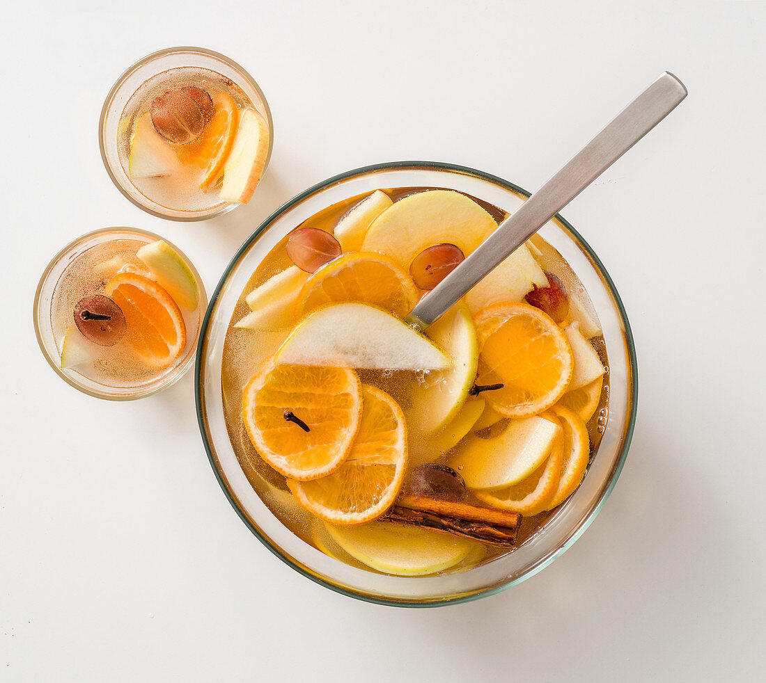 White sangria punch with sparkling wine, apple, pear, orange and grapes