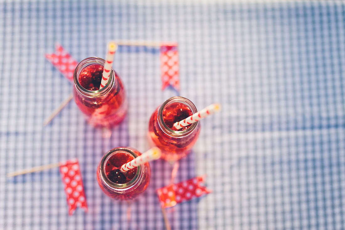 Bottles with fresh berry drink