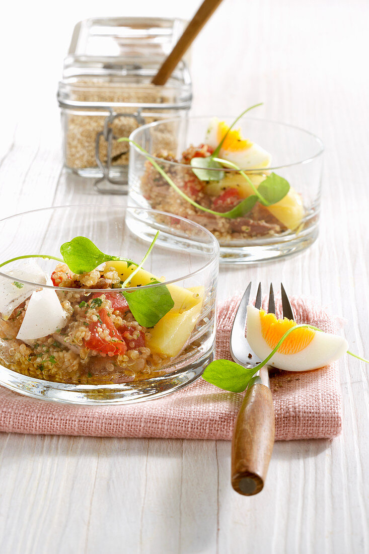 Warm quinoa salad with egg, potatoes and purslane