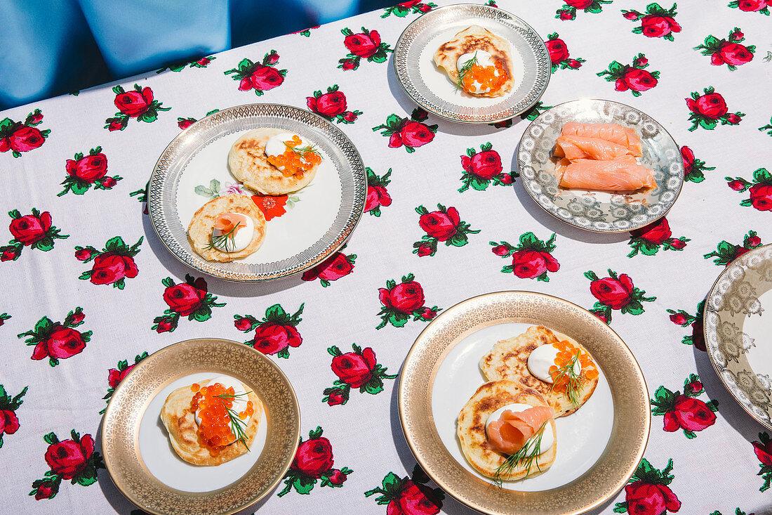 Blinis with sour cream, smoked salmon, and salmon caviar
