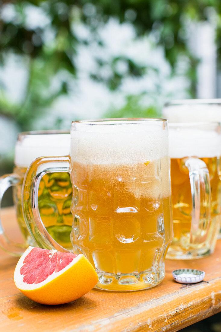 Various beers: elderberry radler and grapefruit beer on a beer garden table