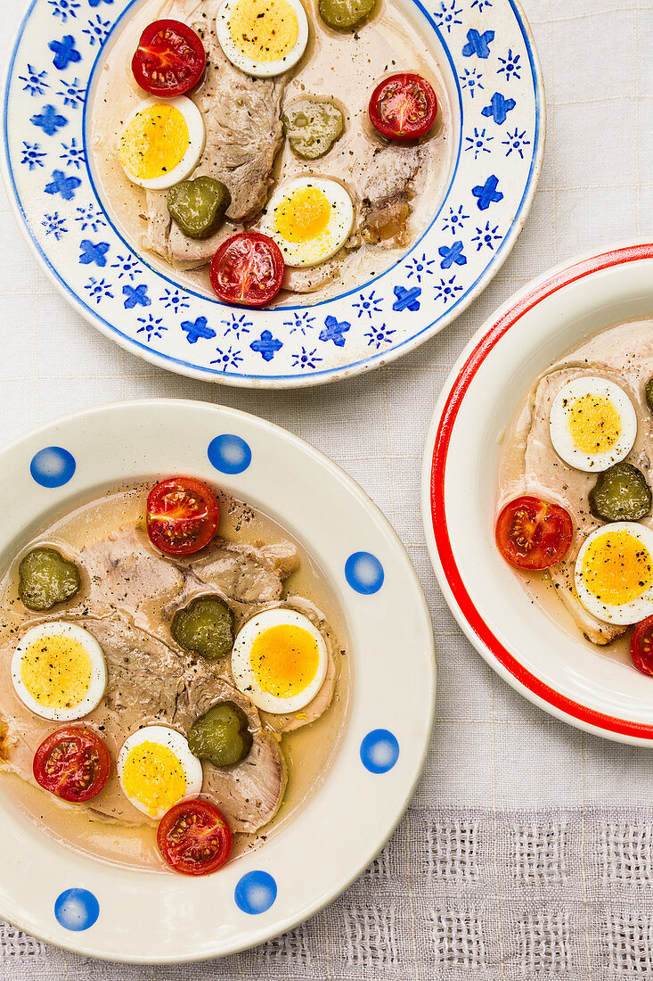 Cauliflower with egg, tomatoes and gherkins