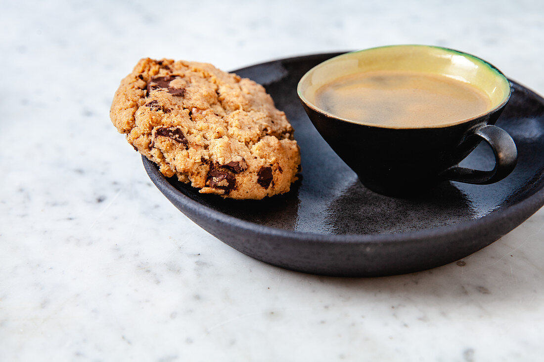A chocolate chip cookie and an espresso
