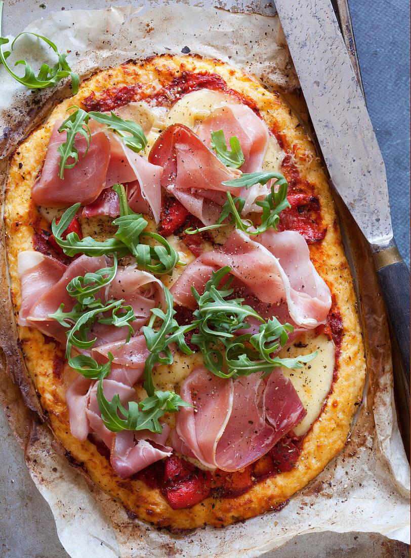 Mozzarella and proscuitto pizza with cauliflower base