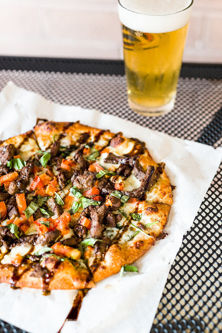 Caprese beef pizza with balsamic drizzle and crunchy crust