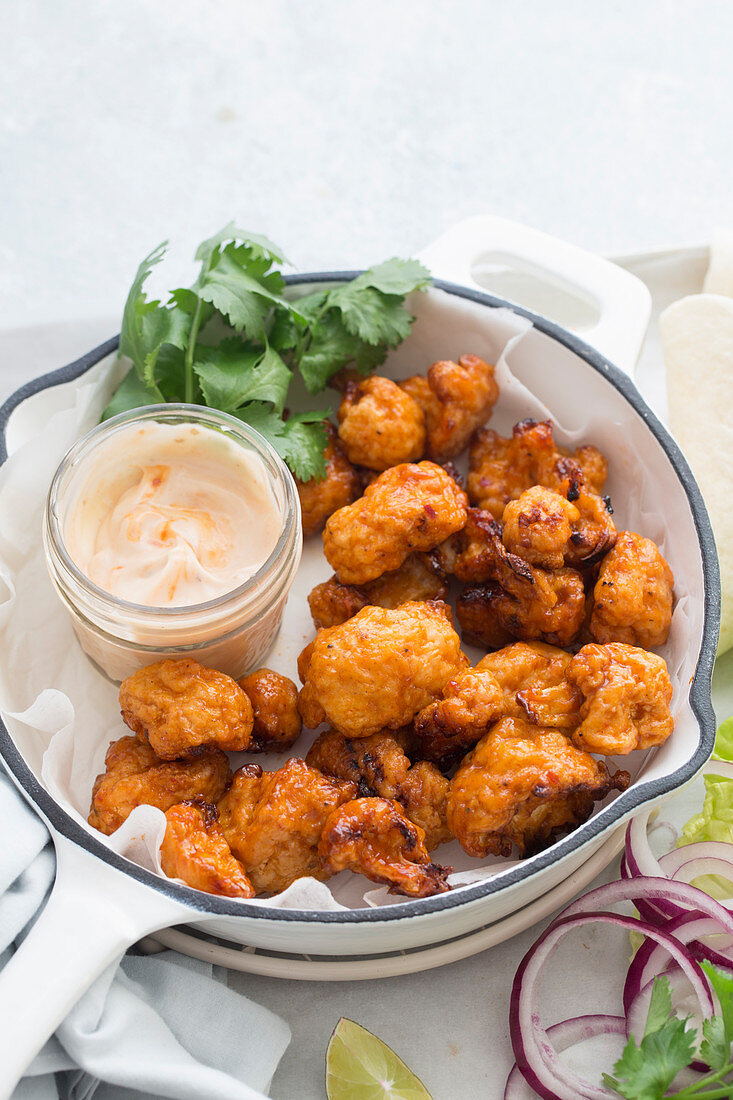 Fried cauliflower bites with a dip