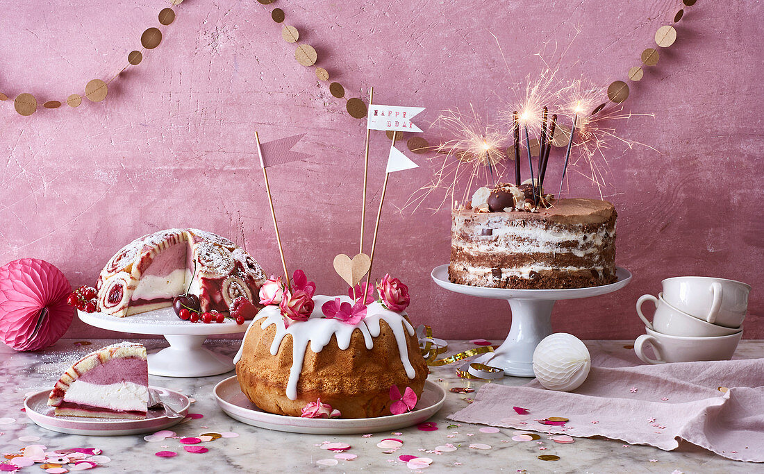 A charlotte royale, a Bundt cake and a naked nougat cake for a birthday