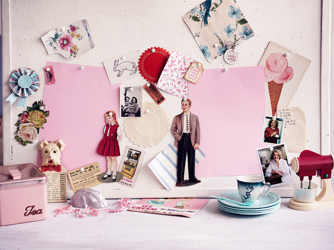 Pin board with nostalgic cutouts and paper dolls